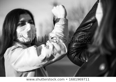 Asian people greeting during Chinese New Day Stock photo © szefei