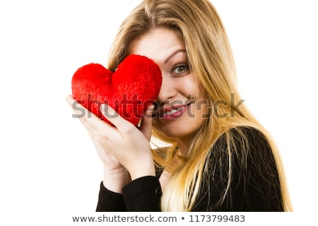 happy and smiling woman with heart shaped pillow stock photo © dolgachov