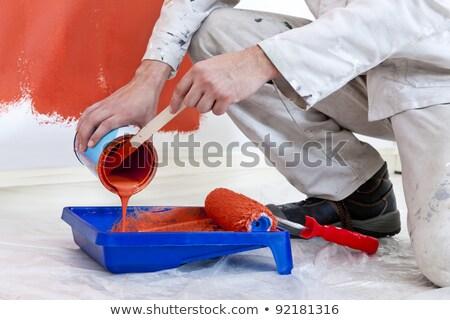 Férfi festék térdel kéz építkezés fal Stock fotó © photography33