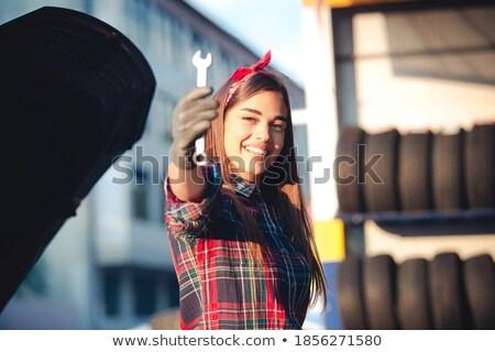 Young female technician holding wrench stock photo © wavebreak_media