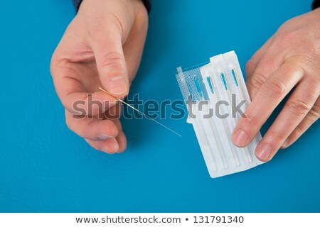 Acupuncture needles in doctor hands holding blister Stock photo © lunamarina