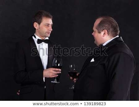 Twee stijlvol zakenman bril rode wijn zwarte Stockfoto © Discovod