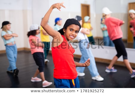 portrait of boy and girl dancing stock photo © zzve