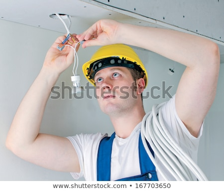 Electrician Mounting Lights Stock photo © Lighthunter