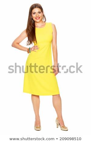 Gülen genç esmer kadın sarı elbise Stok fotoğraf © juniart