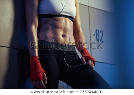 Sweaty woman in locker room Stock photo © CandyboxPhoto
