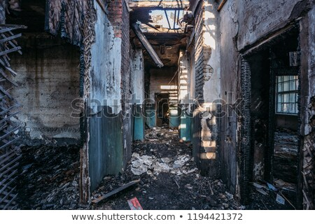 abandoned factory hall and burnt ceiling stock photo © juhku