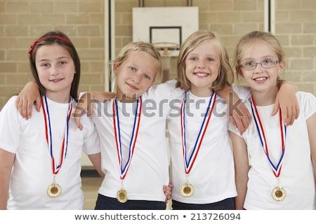 Femenino escuela equipo deportivo gimnasio deporte Foto stock © HighwayStarz