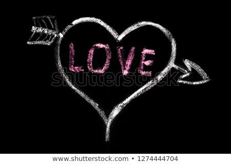 heart pierced by arrow, love symbol on blackboard Stock photo © PixelsAway