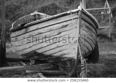 An old clinker built wooden working fishing boat on a trailer stock photo © chrisga