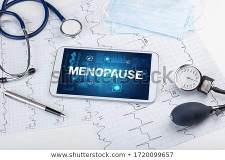Menopause on the Display of Medical Tablet. Stock photo © tashatuvango