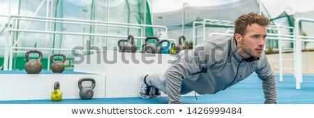 young man exercising pushups stock photo © jasminko