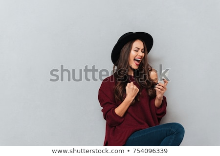 woman using smartphone over gray background stock photo © deandrobot