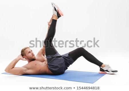 Muscular man doing abs exercise Stock photo © deandrobot