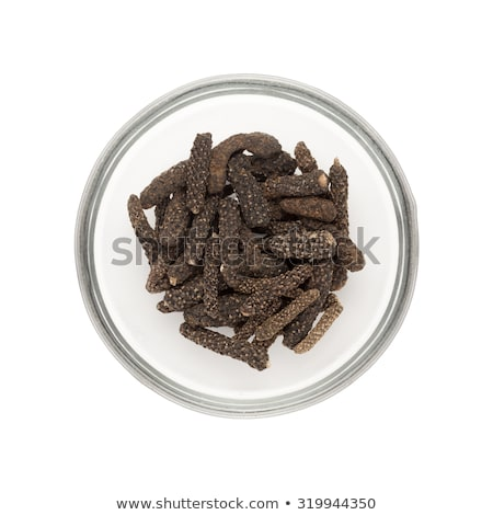 top view of half filled bowl of organic long pepper dried fruit stock photo © ziprashantzi
