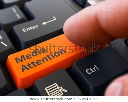 media attention   written on orange keyboard key stock photo © tashatuvango