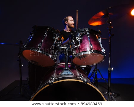 Serious bearded man drummer playing on his kit Stock photo © deandrobot
