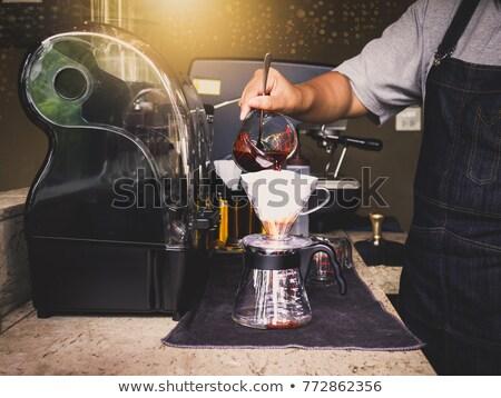 ázsiai barista felajánlás csésze főzet kávé Stock fotó © Kzenon
