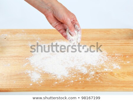 Cook sprinkling flour over a cutting board Stock photo © Digifoodstock