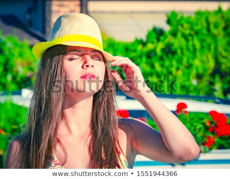 Tanned woman soaking up the summer sun Stock photo © dash