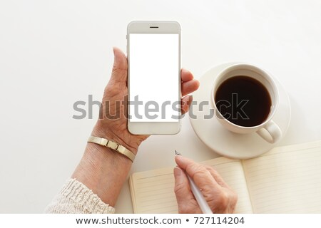 close up of senior woman with smartphone texting Stock photo © dolgachov