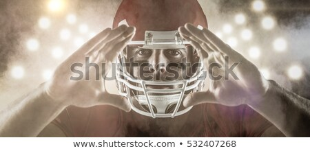 composite image of american football player making hand gesture stock photo © wavebreak_media