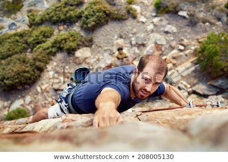 Climber reaching for a grip. stock photo © gregepperson