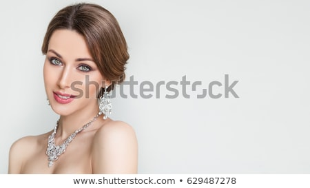 smiling woman in white dress with diamond jewelry stock photo © dolgachov