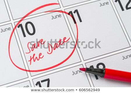 save the date written on a calendar   june 10 stock photo © zerbor