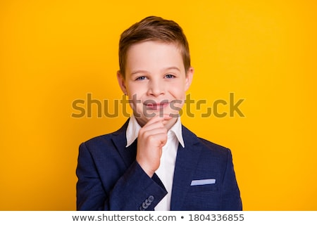 Pequeño nino pensando tocar barbilla Foto stock © deandrobot