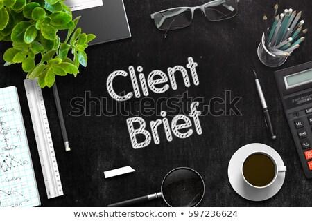 Client Brief on Black Chalkboard. 3D Rendering. Stock photo © tashatuvango