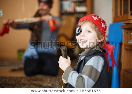 Genç erkek oynama çocuk eğlence Stok fotoğraf © IS2