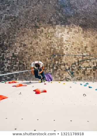 free climber descending boulder stock photo © is2