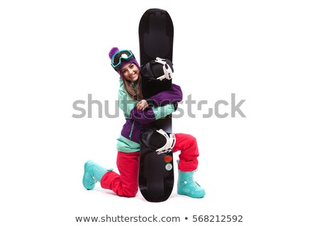 ski woman on one knee hugs snowboard Stock photo © Traimak