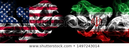 Football in flames with flag of iran Stock photo © MikhailMishchenko