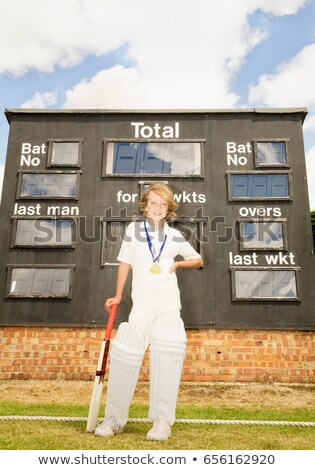 Boy Cricketer with medals and scoreboard Stock photo © IS2