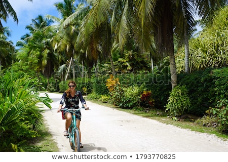 Happy girl cycling surrounded by trees Stock photo © IS2