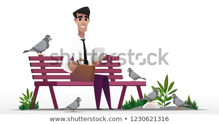 Businessman feeding pigeons in park Stock photo © IS2
