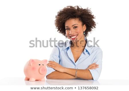african businesswoman sitting on bank safe stock photo © studioworkstock