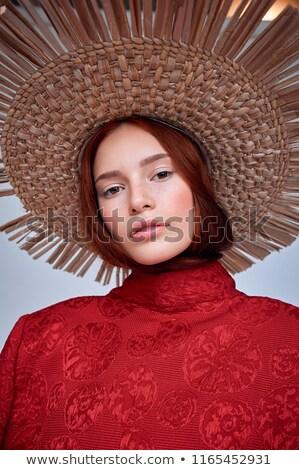 Fashionable redhead woman posing in studio. Stock photo © NeonShot