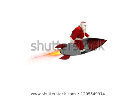 fast delivery of christmas gifts santa claus ready to fly with a rocket isolated on white backgroun stock photo © alphaspirit