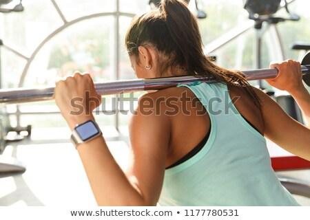 Stok fotoğraf: Arkadan · görünüm · şaşırtıcı · spor · kadın · egzersiz · halter