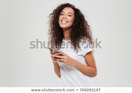 изображение улыбающаяся женщина 20-х годов вьющиеся волосы смартфон Сток-фото © deandrobot