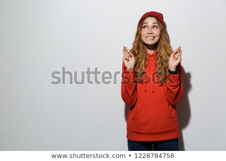 Image of superstitious european woman in basic clothing keeping  Stock photo © deandrobot