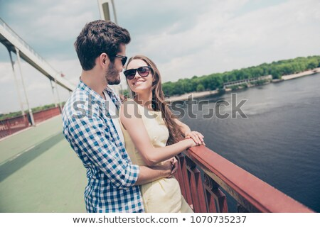 young couple on quay at the sea Stock photo © smeagorl