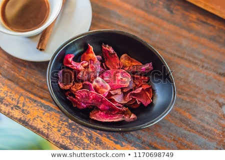 Cup of Luwak coffee with a stick of cinnamon and mangosteen chips served in Bali, Indonesia Stock photo © galitskaya