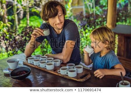 Apa fiú kóstolás különböző kávé tea Stock fotó © galitskaya