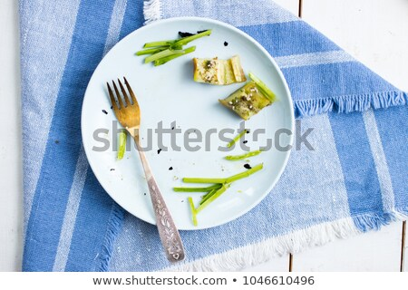 plates with crumbs of food remains of food in plates after lunch or dinner stock photo © galitskaya