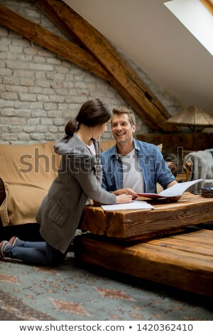 Father and daughter have successfully done homework in the room Stock photo © boggy