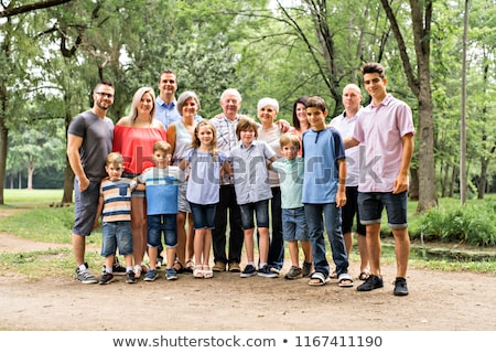 Large family with cousin grandparent father and kid on a forest Stock photo © Lopolo